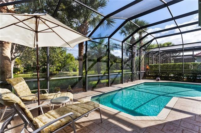 Picture yourself living the Naples lifestyle with this tranquil lakeside setting relaxing in the ove