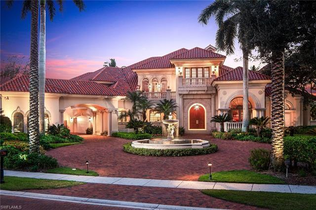 Enjoy spectacular sunsets over scenic water and golf course views from this classically designed est