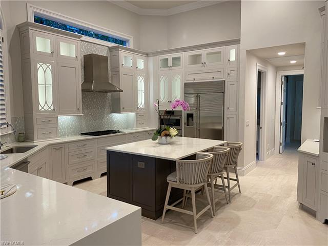 Rare opportunity to own a beautifully renovated home on one of the largest lots in Pelican Bay, offe