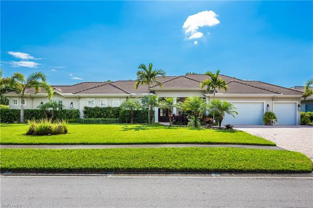 This new single family home is located in much sought after Pelican Bay.  It boasts a bright, open f