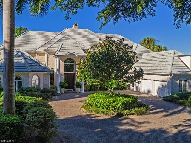 Located behind the gates of exclusive Georgetown in Pelican Bay sits this gracious family home with