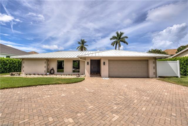 This spacious Park Shore single family 4 bedroom pool home is located on nearly a 1/3rd of an acre h