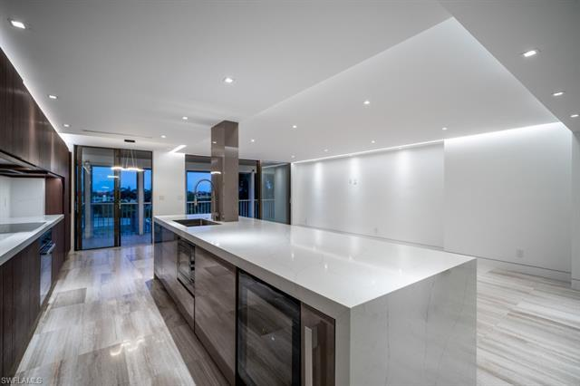 Newly renovated to the highest standards in one of Naples Florida's most desirable beachfront High-r