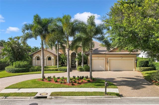 BEAUTIFUL AND UNIQUE spacious home located in the highly desirable Moorings. FIVE blocks from the Gu