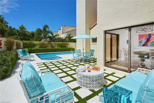 This spacious two-story villa end unit in the Las Brisas community of Pelican Bay features a generou