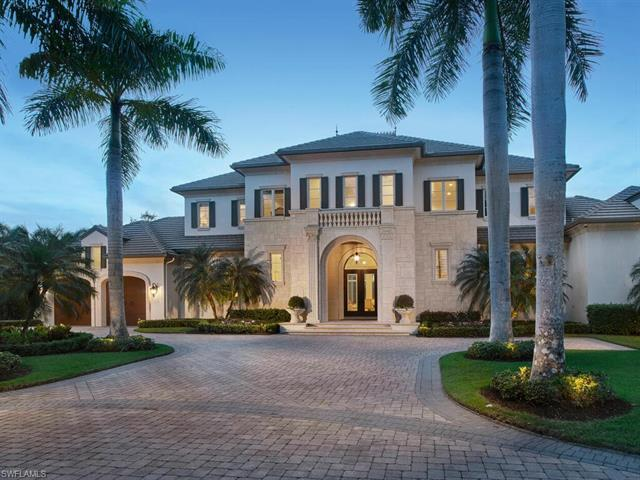 This spectacular custom estate in the exclusive Estuary at Grey Oaks resides on a secluded, private