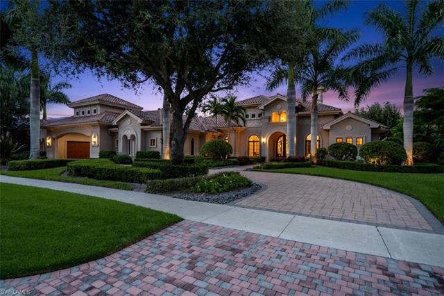 This spectacular Quail West estate, complete with quality builder finishes, offers peaceful lake and