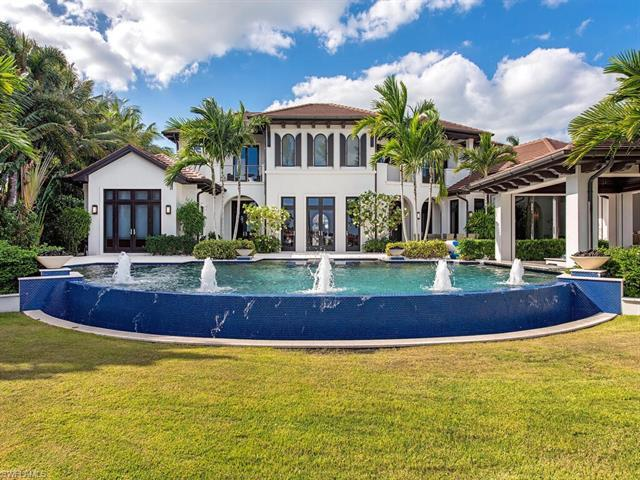 A once in a lifetime opportunity to own this legacy home in Aqualane Shores. Situated on an oversize