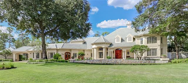 Situated on a 1.3-acre lot, this lovingly designed and custom-built 2-story Country French masterpie