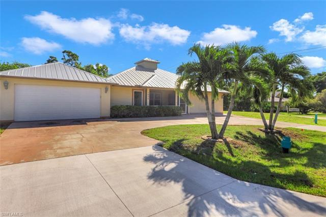 This centrally located, rarely available FOUR bedroom beach bungalow enjoys a great location just east of US41 (Tamiami Trail) and close to the popular Naples beaches and downtown area.  Features include a metal roof (2019), new pool enclosure (2019) and new luxury vinyl flooring (2020), stainless steel appliances, granite counters in the kitchen, wood cabinetry and an enclosed lanai with a pool, paver deck and private preserve views.  With over 2,100 SF of interior living space, this home has vaulted ceilings, an open floor plan with an open kitchen, a separate family/flex room, plenty of entertaining space and a two car garage. Best of all - no homeowners association fees.  The neighborhood is minutes to shopping & dining, Naples beaches, 5th Ave/3rd St, Mercato, Waterside Shoppes, Venetian Village, Baker Park, the Greenway, Fleischmann Park, the Naples Zoo, Artis Naples and many other Naples amenities.  Highly rated public schools include Lake Park Elementary, Gulfview Middle School and Naples High School. This is a great home for a family looking for top-rated schools or for an investor looking for a rental property.  Come enjoy the Naples lifestyle in this wonderful home!