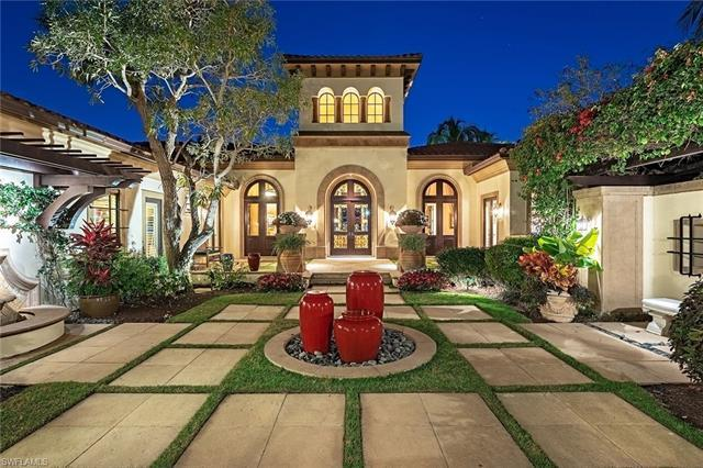 This magnificent custom golf estate resides on a picturesque .77 acre long range view lake to golf h