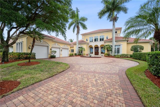 Masterfully crafted custom Executive Retreat with alluring views of the Pelican Marsh golf course an