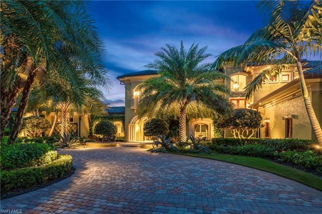OVER ONE ACRE GOLF COURSE ESTATE IN THE HEART PELICAN BAY.  Amazing resort-like courtyard pool home