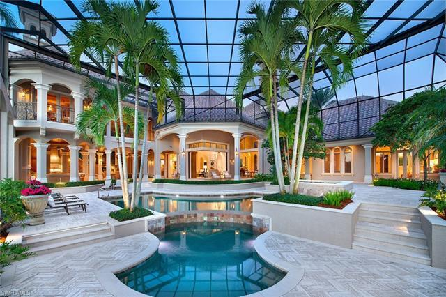 This recently updated custom estate exudes quality throughout and resides on an incredibly private w