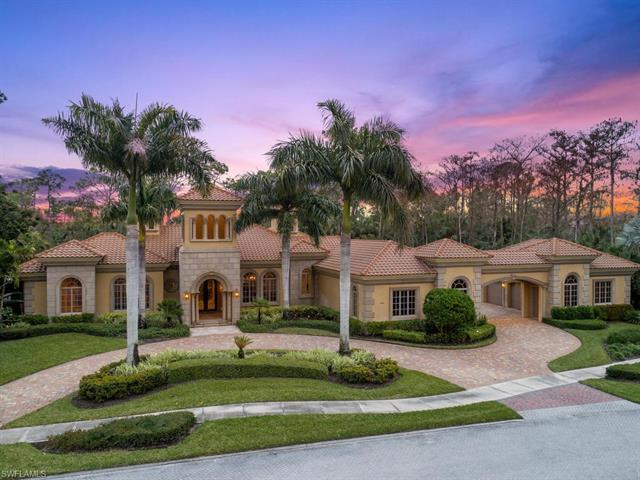 This beautiful Quail West Estate built by Diamond Custom Homes offers dramatic golf views and emphas