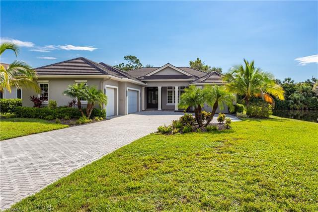 This new single family home is located in much sought after Pelican Bay.  It boasts a bright and ope