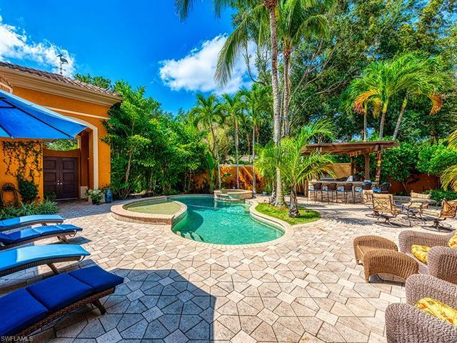 Welcome to this resort style paradise in beautiful Grand Isle of Pelican Marsh! Enter the landscaped
