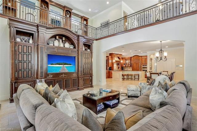 WOW! IMMACULATE home in coveted Logan Woods of Naples Florida! It has features of a Brand New build