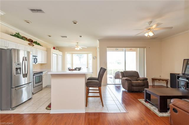 V.2856 -  PRICE REDUCTION!!!Must see! Charming 2 BR/2BA villa. Enjoy endless golf course views without the golf course price. Relax on your spacious screened lanai. Large open kitchen  with several upgrades including stainless steel appliances and a bar that easily seats 4. Heritage Greens offers one of the most popular public golf courses with amazing clubhouse. Come enjoy the Naples lifestyle and partake in the many community activities- clubs, classes, tennis, 2 community pools, spa & exercise room.