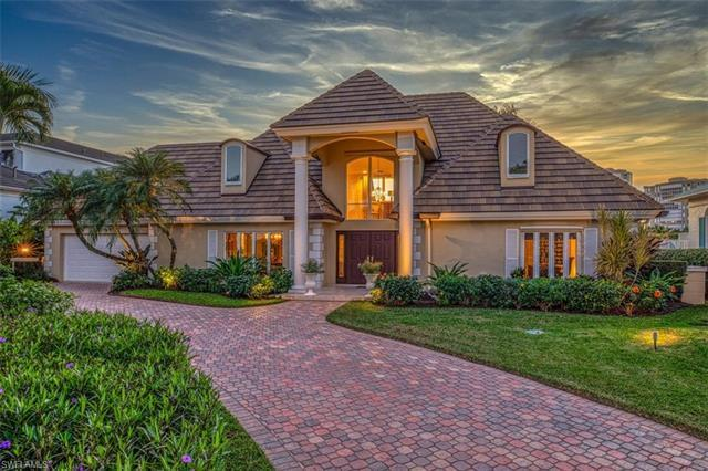 This magnificent waterfront home is located on Venetian Bay - one of the most sought-after areas in