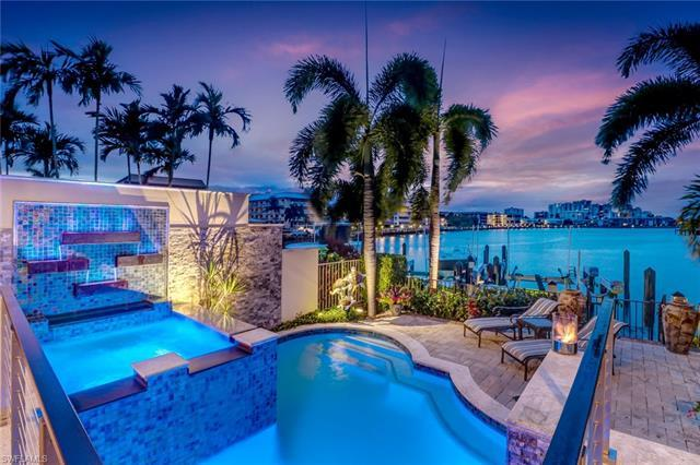 This property embodies the Naples lifestyle. Situated on Moorings Bay, the long water views scan to