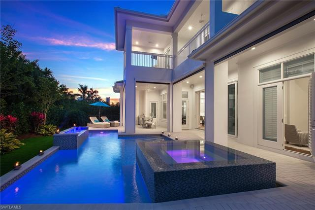 Coastal contemporary design and clean lines define this beautiful British West Indies-style home. Sh