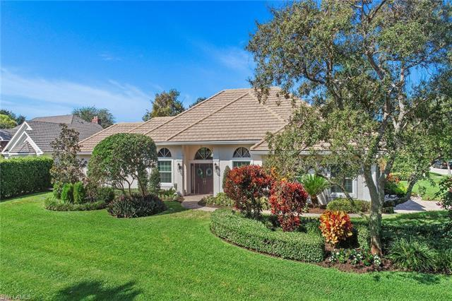 Located on a beautifully landscaped quiet corner, five houses from Oakmont Lake and Park in Pelican