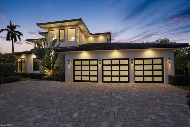 Newly completed, this home sets a new standard for architectural excellence in Naples. As you enter