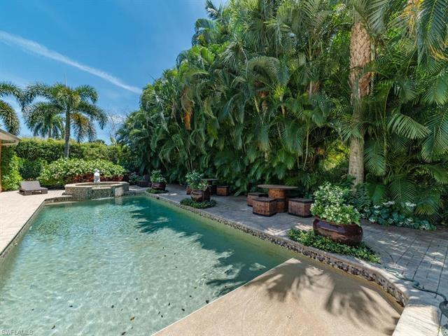 Walk to the beach, shopping and restaurants from this luxurious Moorings residence of over 5000 SF w