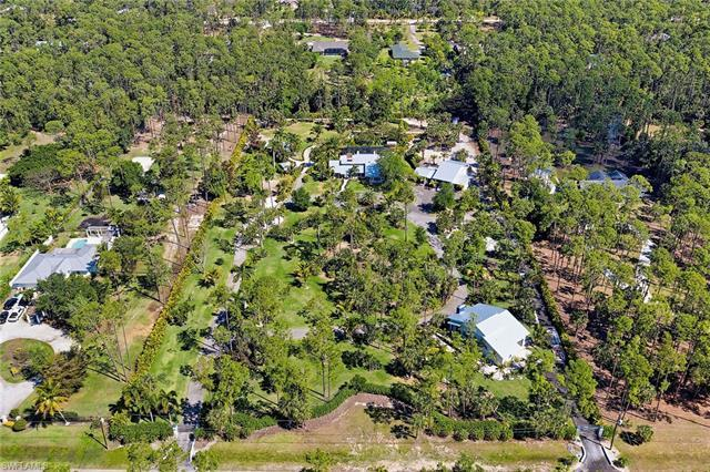INCREDIBLE FAMILY COMPOUND - This 5 acre, lushly landscaped, entertainment hub is perfectly tucked w