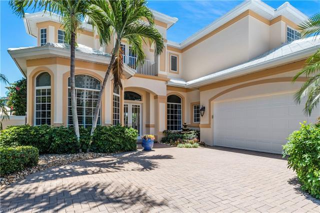 Rarely available detached single family home in Carlton Place Pelican Bay with gorgeous lake and gol