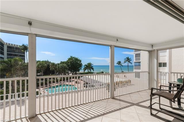BEACH AND GULF VIEWS! Direct Beach Access. Shows like a model! If you dream of sitting on YOUR lanai