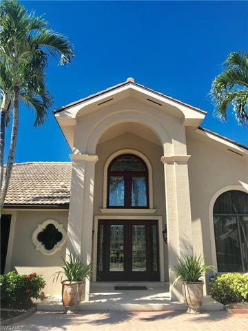 Beautiful 4,337 f.t. home in the prestigious neighborhood of Pelican Bay Woods. With its expansive c