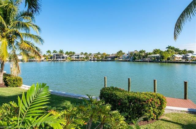 Enjoy unbelievable water views with 106' on Moorings Bay from this custom built estate home.  The ma