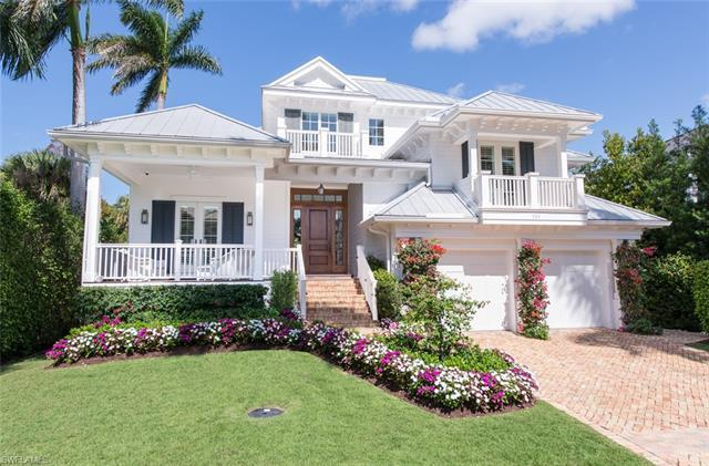 Gorgeous custom home on one of Old Naples' most desirable southern streets. Cross the gracious front