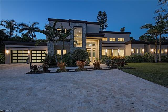 Sleek, luxurious, sprawling and sophisticated describe this magnificent newer home in the Moorings w