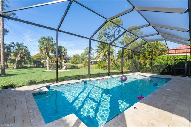 H.15516 - Four bedroom+den two story pool home in popular Autumn Woods. SeaGate Elementary, Pine Ridge Middle, Barron Collier HS. This home has a stunning view of the lake and has a bright and open floor plan with 4 bedrooms + Den, 2.5 bathrooms and almost 2400 square feet under air. The pool was installed in 2018. New AC and new hurricane protection in 2018.  The master bedroom is on the ground floor. Upstairs you will find 3 bedrooms and a renovated full bathroom (with both a shower and soaking tub). The kitchen has floating shelves, newer stainless steel appliances and granite countertops. The light fixtures and ceiling fans were replaced in the last few years. New window treatments, plantation shutters, and complete hurricane protection (accordion shutters). All bedroom closets have (2018) custom systems. Laundry room has plenty of storage and newer washer and dryer. Hardwood floors throughout, tile in kitchen and carpeting in upstairs bedrooms. This home has one of the best backyards in the entire neighborhood. Plenty of room to play and you can even fish in the lake behind the house. Autumn Woods is in a premier location, minutes to the beach, Mercato, and shopping.