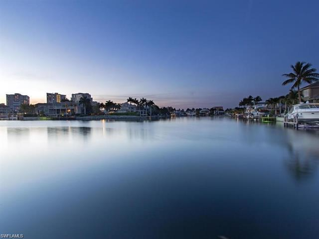 This Spectacular New Construction,  Bay front Property welcomes you with breathtaking views & with t