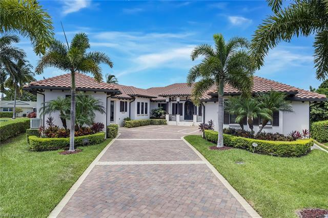 Like new, coastal contemporary home in sought-after Royal Harbor. Discover luxurious living at this