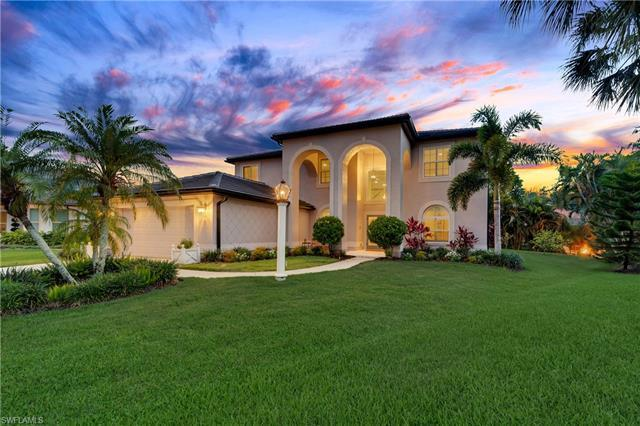 EASY LIVING in this 5 bdrm/3 full bath completely remodeled home.  NEW impact windows & doors, NEW t