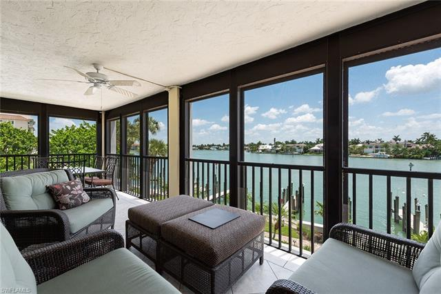 This spacious 3-bedroom unit has a large screened balcony with beautiful Moorings Bay views to watch