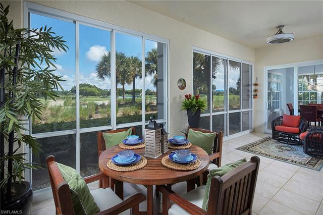 Stunning 1st floor golf course residence in Osprey Pointe at Pelican Marsh. Imagine sitting on your