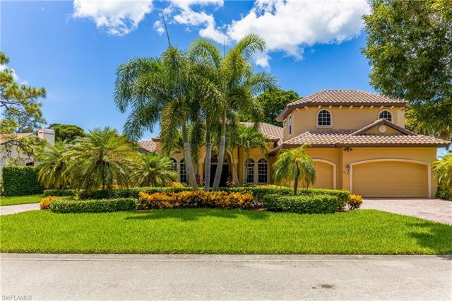 This large estate home, in the heart of Pelican Bay, boasts 5 bedrooms plus den, 4 and a half baths,