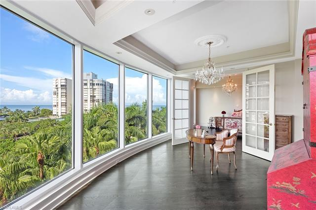 On the beach in the heart of Park Shore, panoramic views await you in this stunning home at Provence