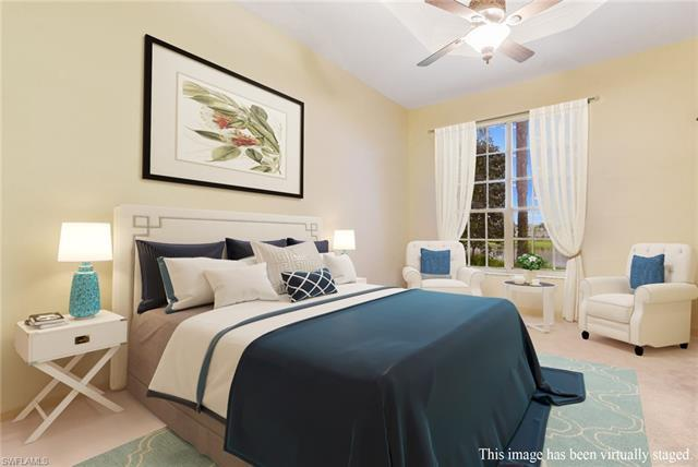 LOWEST PRICE PER SQUARE FOOT IN PELICAN MARSH. Welcome home to your lakefront retreat at Island Cove