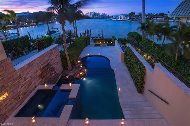 Enjoy dramatic bay views immediately upon entry in this four-bedroom, six-bath villa. The best of al