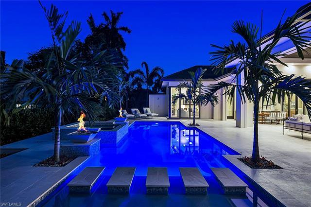 Centrally located in the Moorings, this new construction luxury home built by the highly sought afte