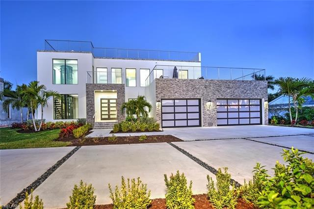 Must see!!! Brand new contemporary home with stunning sunset views from the rooftop deck. This 4 bed