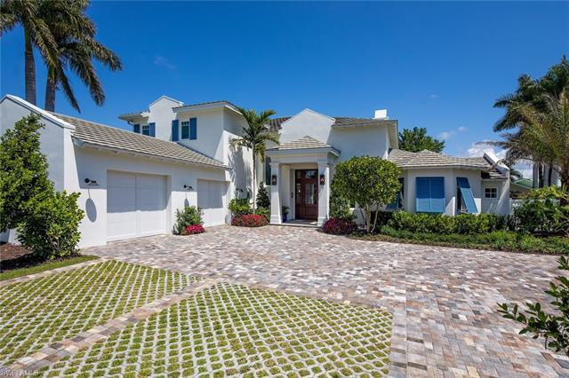 Located on a quiet cul-de-sac in prestigious Park Shore this home has been beautifully remodeled by