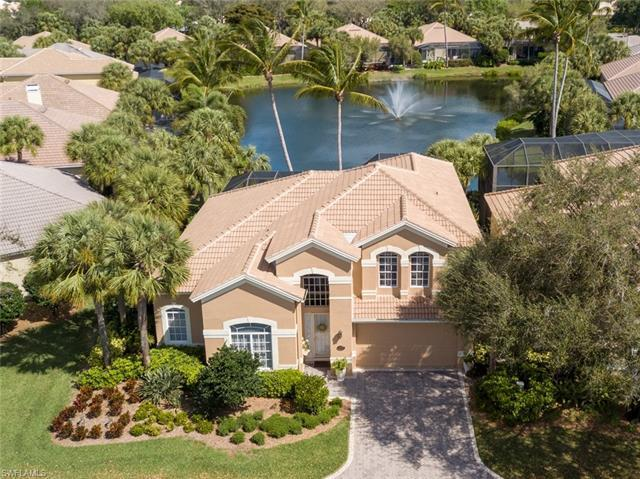 Meticulously maintained and renovated two story gated Pelican Marsh / Island Cove pool/jacuzzi home